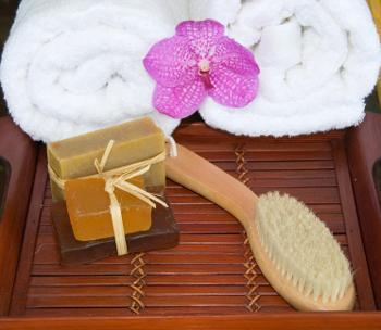 Bath soap, scrub brush, and towel