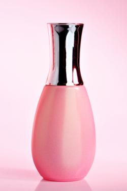 Bottle of opalescent pink nail polish