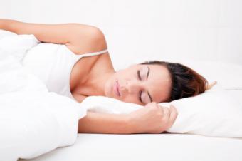 Woman sleeping on left side