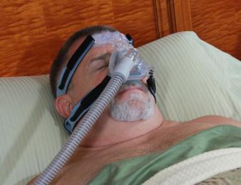 Man with sleep apnea sleeping in worst position; © Gary Arbach   Dreamstime.com