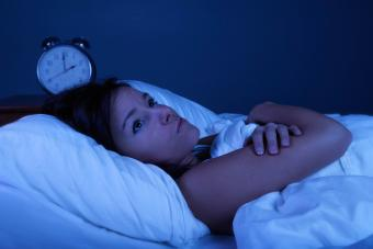 woman in bed with insomnia