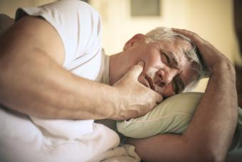 Man experiencing dental pain