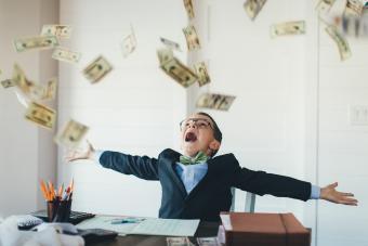 Cash raining on a boy