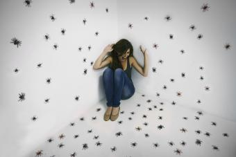 Woman having nightmare about spiders