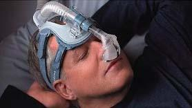 Peaceful sleep with a CPAP machine and mask.