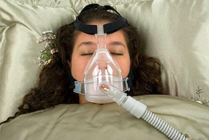 woman wearing CPAP mask