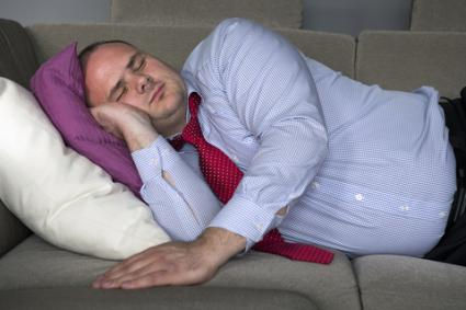 Business man sleeping on couch; © Wernerimages | Dreamstime.com