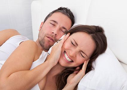 Woman disturbed by sleeping man
