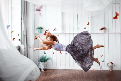 Woman flying with butterfly