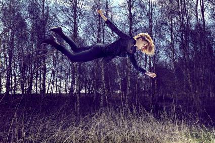 Floating woman in a field