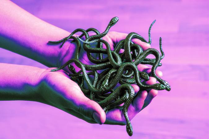 Boy holding a snakes