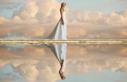 bride reflected in still lake