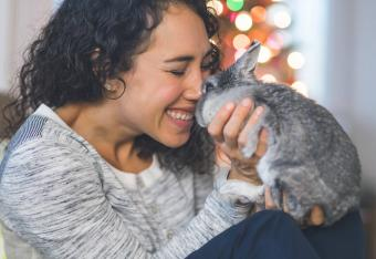 Woman snuggles with her fluffy little bunny