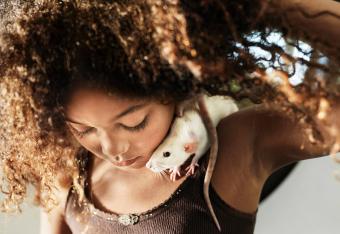 Girl with rat on shoulder