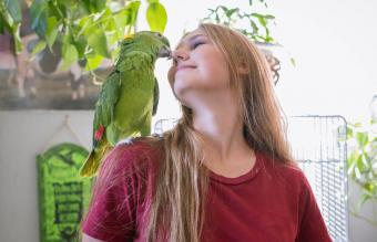 woman at home with her parrot