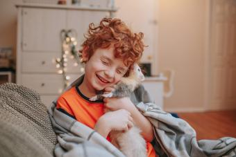 Boy Playing with Pet Ferret