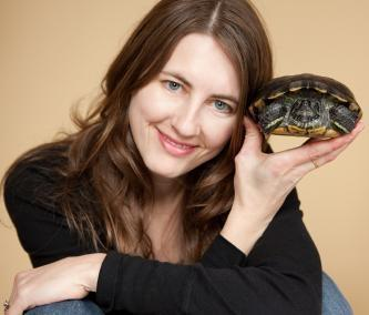 Woman with a red-eared slider