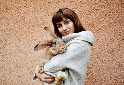 Woman Holding Rabbit