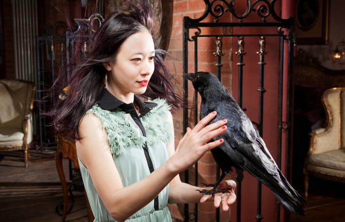 Woman holding crow