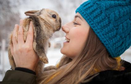 Woman holding rabbit