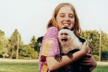 Girl Holding Monkey