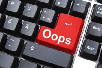 Red Oops key on a computer keyboard