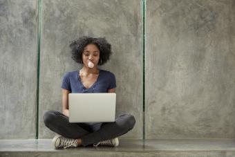 Girl seated using laptop