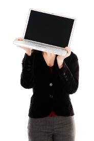 Woman hiding behind her laptop