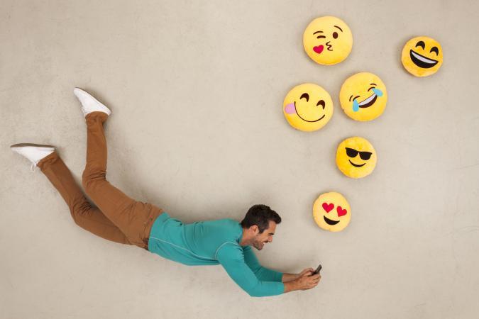 A man sending emojis