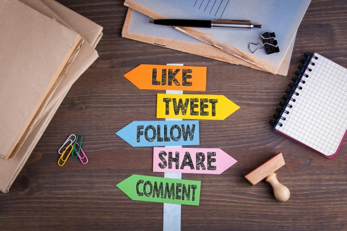 Social media signpost on desk