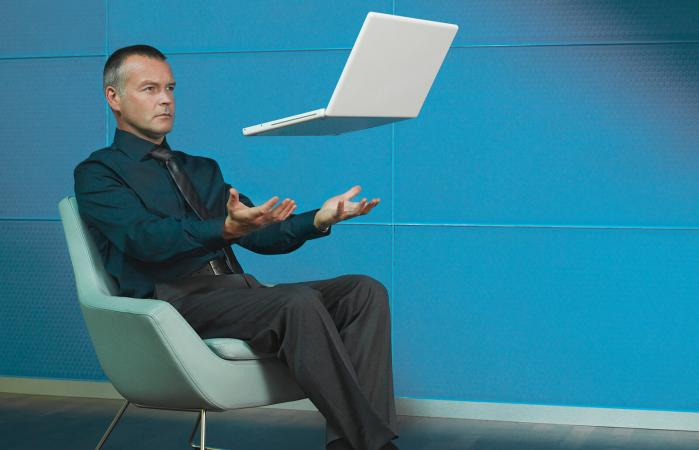 Man sitting with laptop floating