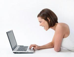 Woman using social media and laughing