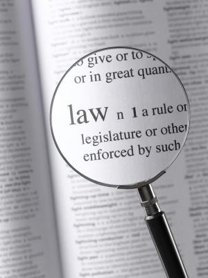 Magnifying glass over the definition of a law
