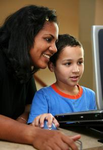 Teacher helping student at the computer