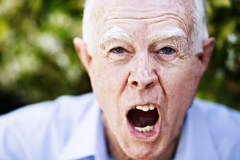 Angry old man yelling at camera