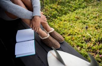 cozy woman reflects in her journal