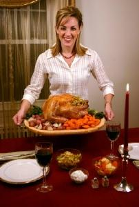 Woman serving a Thanksgiving turkey