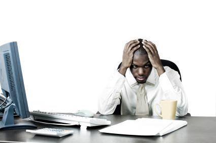 anxious man at desk