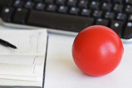 Stress ball next to a computer