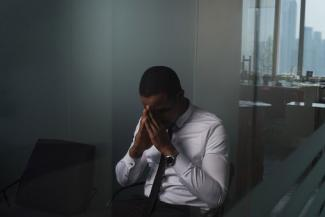 Stressed business man in office