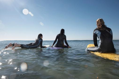 girls on surfboards