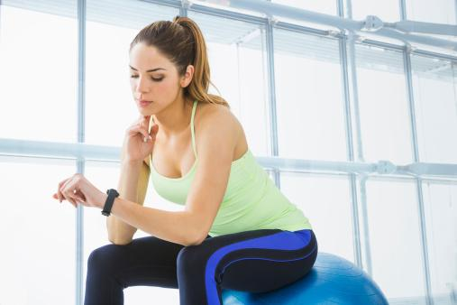 woman checking her pulse in gym