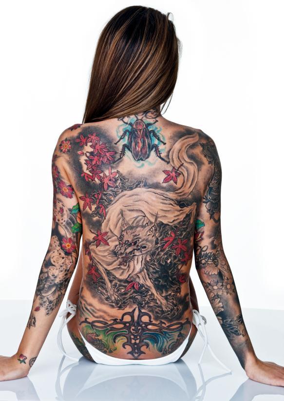 https://cf.ltkcdn.net/tattoos/images/slide/156576-583x823r1-Wolf-tattoo.jpg