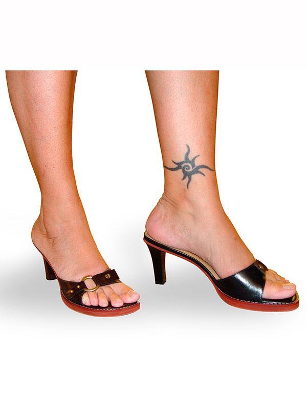 https://cf.ltkcdn.net/tattoos/images/slide/183739-600x800-tribal-star-tattoo.jpg