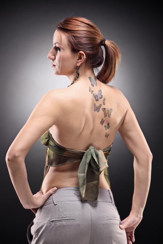 https://cf.ltkcdn.net/tattoos/images/slide/25724-566x848r1-butterflies-on-the-back-girly-tattoo.jpg