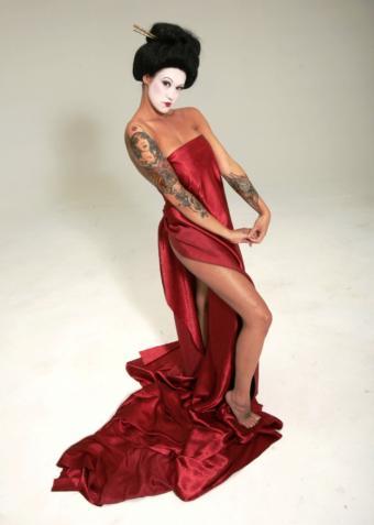 https://cf.ltkcdn.net/tattoos/images/slide/10900-605x850-geisha_with_tattoos.jpg