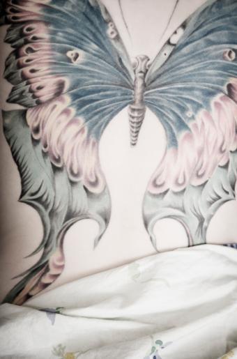 https://cf.ltkcdn.net/tattoos/images/slide/141224-561x850r1-large-butterfly.jpg