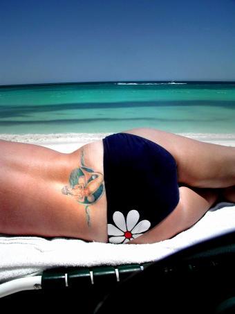 https://cf.ltkcdn.net/tattoos/images/slide/141225-638x850r1-mermaid.jpg