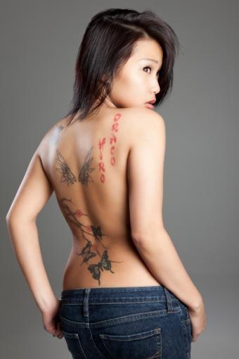 https://cf.ltkcdn.net/tattoos/images/slide/141353-566x848r1-multiple-back-tattoos.jpg