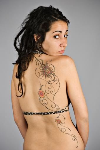 https://cf.ltkcdn.net/tattoos/images/slide/141357-567x847r1-asymetrical-scroll.jpg